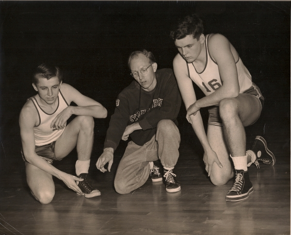 Coach O. Floyd Johnson directs co-captains Scott Humphrey and Elmer Nelson