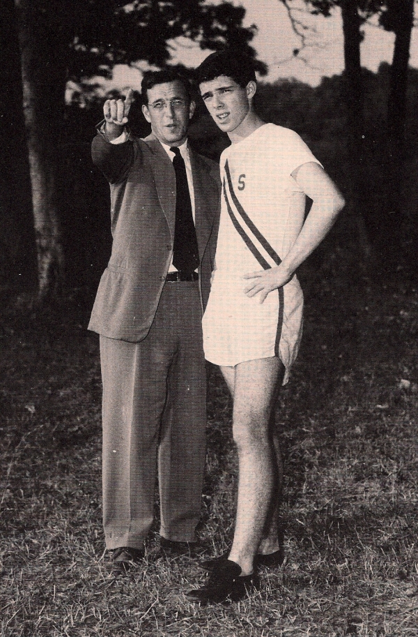 1952   Coach Goldberg advises captain Jim Osuna