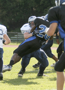 All-Division Captain Mike Borruso makes a tackle