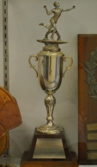 The 1966 St. John's Trophy sits in a Swanson display case