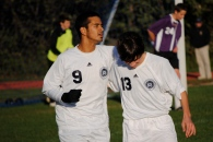 Matt Schneider celebrates with Anuraag Sah after his goal