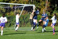 Michelle Hennessey heads the ball out of the keeper's grasp to tie the game at 1-1