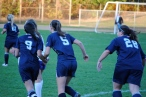 The girls joyously run back after Emily Andersen made it 4-2