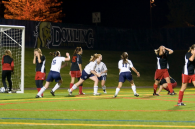 The girls react after Sadie Singer knocks in the game-winner