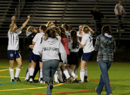 The team rushes the field after the goal
