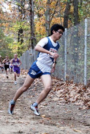 Yisheng Cai, Stony Brook's top finisher, rounds the corner after coming down Snake Hill