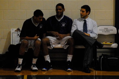 Farqu Taylor sits between the two newest members of the 1,000 point club
