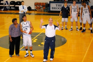 Coach Mike Hickey tells the crowd just how many are in the 1,000 point club