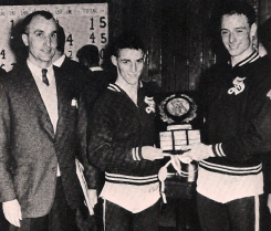 Captains Jack Emery (left) and Bill Johnson hold up the Ivy League Championship plaque