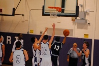 Tim Pandolfi finishes a difficult layup in traffic