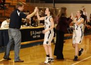Coaches Jeremy Donovan and Amy Helm congratulate their girls