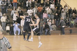 Knowles (#33) and Pete Carmel celebrate at mid-court
