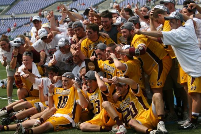 Titus (Back, middle) celebrates after an undefeated 2007 season
