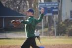 Assistant coach Kyle Cavanaugh delivers a pitch