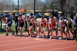 Wyatt Piazza (far left) and Yisheng Cai (3rd from right) line up for the 1500 meter run