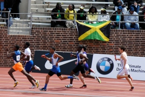 Lawson motors down the homestretch with the flag of his nation behind him
