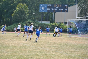 Hon. Mention: Michelle Hennessy lofts her equalizing corner kick toward the goal