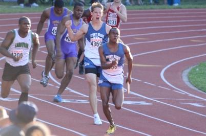 1. Jon Wentling roars as Khoren Lawson thunders down the straightaway toward a 42.96 school record in the 4x1 relay