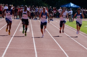 The trio charges toward the finish line