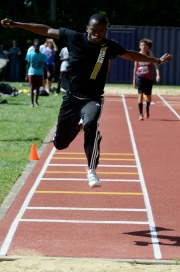 Lawson practices his form in the triple jump