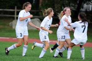 The girls celebrate Barker's goal