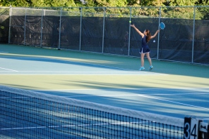 Julia Braat serves during her second doubles match