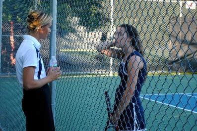 Coach Crane & Olivia talk between sets