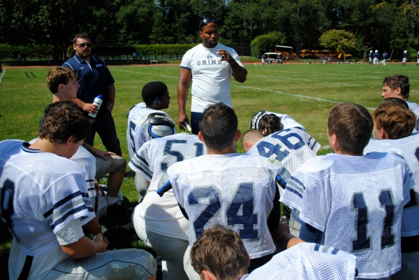 Head coach Kris Ryan talks to the boys after their scrimmage vs. Friends Academy last Saturday