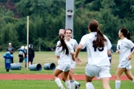 The girls celebrate Lavery's eventual game-winner
