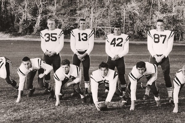 The '60 Gridders: McLean (#35), Johnson (#13), MacKenzie (kneeling, 3rd from L), Cloos (kneeling, middle)