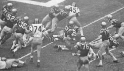 Visted (#52) plays in the 1961 Orange Bowl