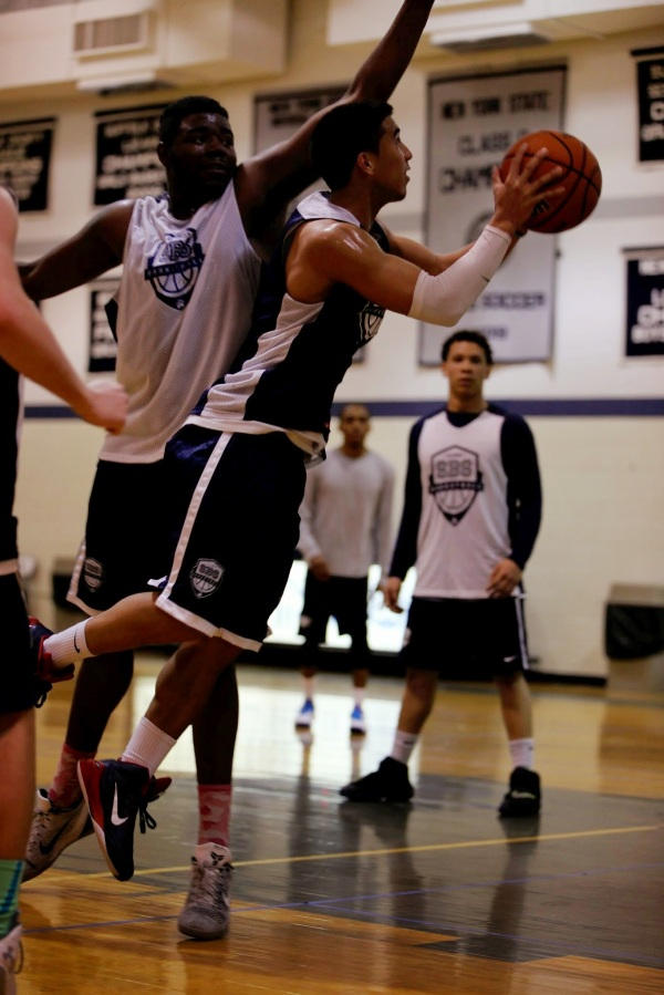 Marco Masakayan '13 drives against Jovan George '11 in the Young Guns game