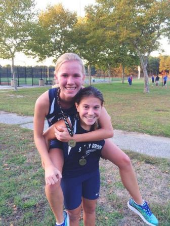 Miranda Harrigan gives Cianka Haynes a ride after they medaled for the Brook