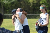 Bri Kilkenny gives a hug to Marlee Painter during the senior ceremony