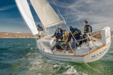 The Sea Wind slices through Port Jeff Harbor during the spring keelboat season (PC: Bruce Jeffrey)