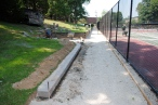 The chain link fencing surrounds the courts