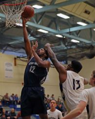 Jyles Etienne elevates for a bucket