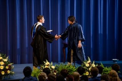 Harry Hou accepts the Brohard Wrestling Award