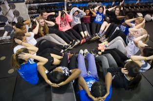 The girls strength & conditioning class finishes a workout with some core exercises (PC: Bruce Jeffrey)