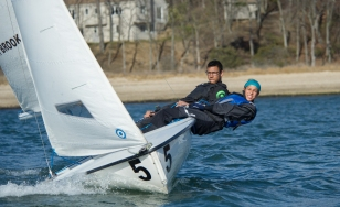 Josie Levy & William Meitz hang over the port side during the spring dinghy season (PC: Leslie Paige)