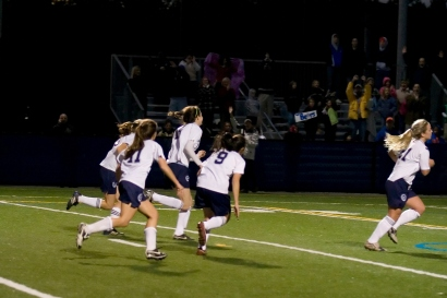 The Bears jog back as the crowd celebrates Michelle Hennessy's opening goal