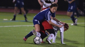 Esther Lee takes down a Southold player