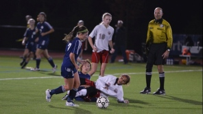 Emily Pius grabs the ball after a collision