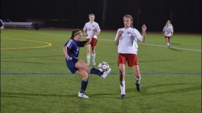 Emily Pius volleys the ball
