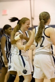 Singer's teammates swarm her after her milestone basket