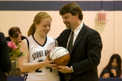 Singer is given a ball by her father and head coach, Keith Singer