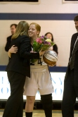 Singer is given flowers by her aunt and asst. coach, Amy Helm