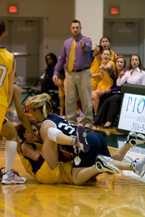 Liotine wrestles for the ball