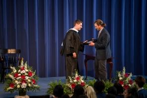 Dustin Mones accepts the Marvin W. Goldberg Coach's Award