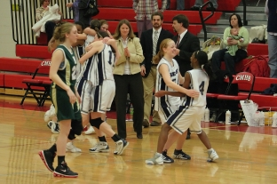 The girls celebrate the title